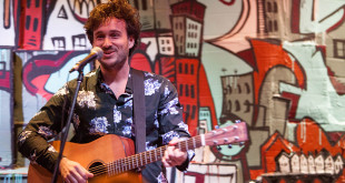 Caleb Hawley playing guitar